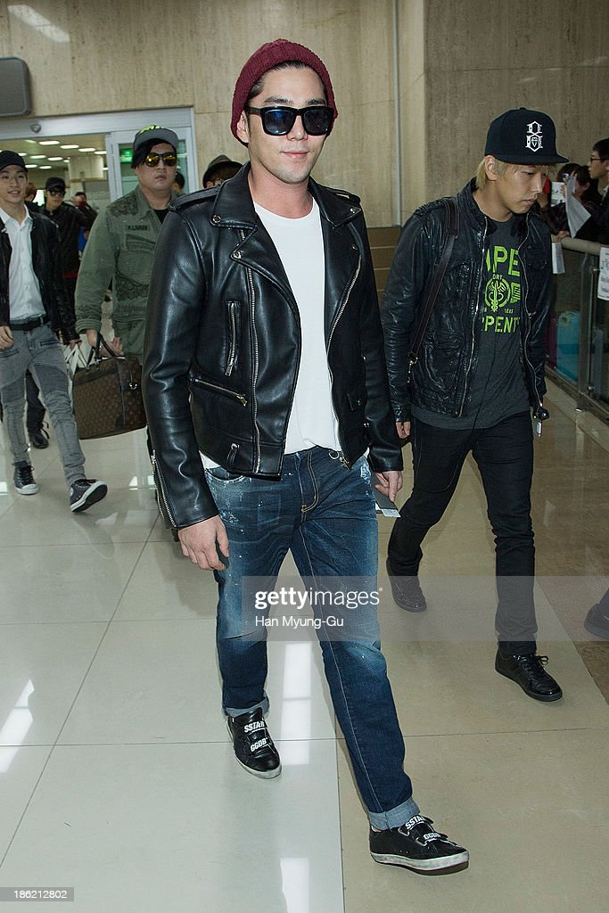 Kangin of boy band Super Junior M is seen upon arrival at the Gimpo Airport on October 28 2013 in Seoul South Korea