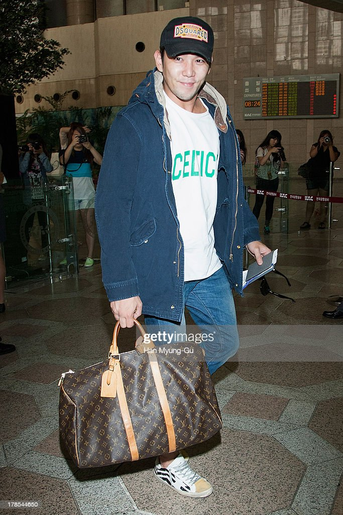 Kangin of South Korean boy band Super Junior is seen on departure at Gimpo International Airport on August 30, 2013 in Seoul, South Korea.