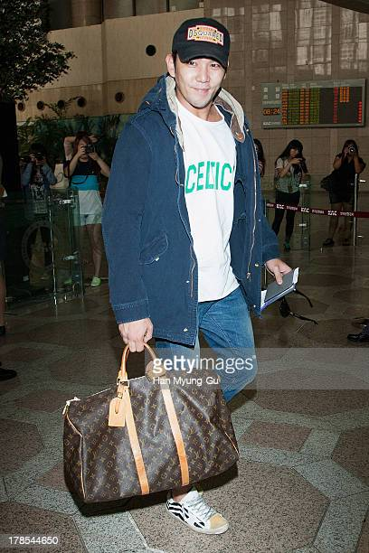Kangin of South Korean boy band Super Junior is seen on departure at Gimpo International Airport on August 30 2013 in Seoul South Korea