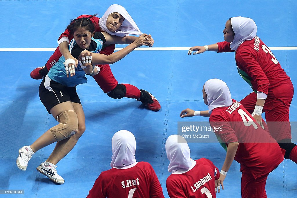 Kangkeeree Namfon #2 of Thailand is tackled by Salimeh Abdollahbakhsh of Iran during the Kabaddi Women's Team Preliminary Group A Match 5 between at Ansan Sangnoksu Gymnasium on day three of the 4th Asian Indoor & Martial Arts Games on July 1, 2013 in Incheon, South Korea.