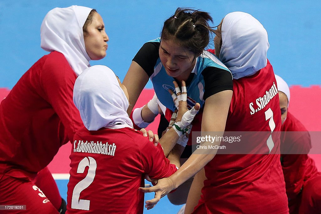 Kangkeeree Namfon #2 of Thailand is tackled by the Iran defence during the Kabaddi Women's Team Preliminary Group A Match between Iran and Thailand at Ansan Sangnoksu Gymnasium on day three of the 4th Asian Indoor & Martial Arts Games on July 1, 2013 in Incheon, South Korea.