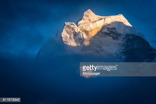 Kangtega 6782m Snow Saddle mountain summit at sunset Himalayas Nepal