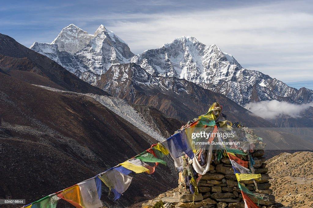 Kangtega and Thamserku mountain behind prayer flag, Everest region