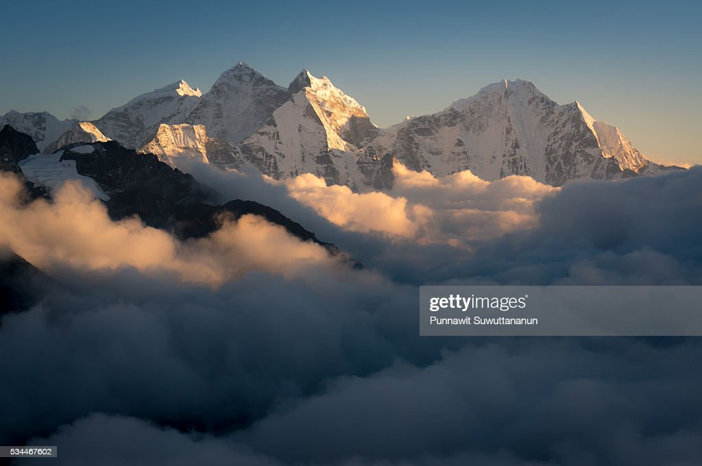 Kangtega and Thamserku mountain peak above the cloud, Everest region