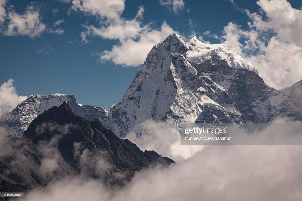 Kangtega mountain peak above the clouds, Everest region