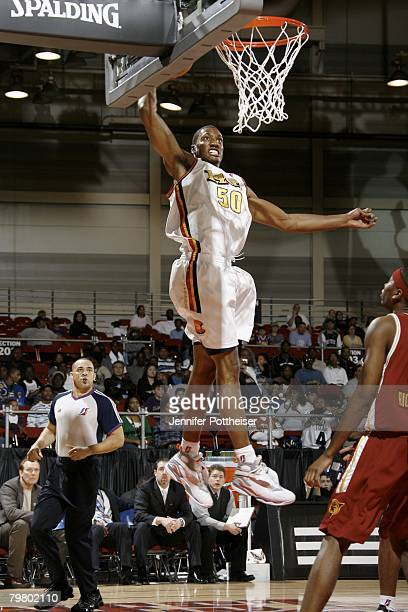 Kaniel Dickens of the Red team soars for a dunk against the Blue team during the DLeague AllStar Game Presented by Spalding during AllStar Weekend on...