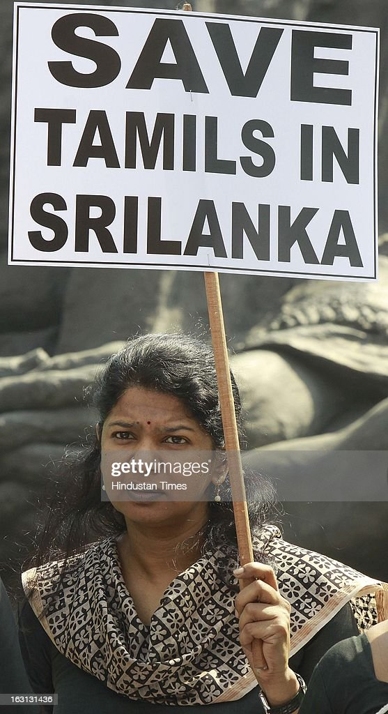 Kanimozhi hold placard with black dress during a protest against Sri Lankan President Mahinda Rajapaksa as they condemn the killing of Tamilians in Sri Lanka at Parliament House on March 5, 2013 in New Delhi, India. Both houses of Parliament were adjourned till noon after opposition parties raised various issues including the killing of a police officer in Uttar Pradesh and protests over the alleged killing of slain LTTE chief Prabhakaran's son in custody by Sri Lankan forces.