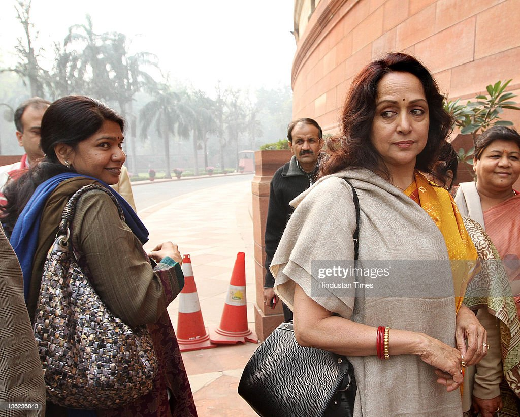 Kanimozhi, Rajya Sabha MP of DMK Party with BJP leader <a gi-track='captionPersonalityLinkClicked' href=/galleries/search?phrase=Hema+Malini&family=editorial&specificpeople=1026787 ng-click='$event.stopPropagation()'>Hema Malini</a> at Parliament House during the ongoing parliamentary winter session on December 29, 2011 in New Delhi, India. The Rajya Sabha is set to vote on the Lokpal Bill later today. The passage of the bill in upper house is not going to be easy as around 187 amendments are moved from the opposition parties as well as allies like TMC.