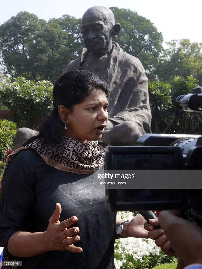 Kanimozhi talking with media persons during a protest against Sri Lankan President Mahinda Rajapaksa as they condemn the killing of Tamilians in Sri Lanka at Parliament House on March 5, 2013 in New Delhi, India. Both houses of Parliament were adjourned till noon after opposition parties raised various issues including the killing of a police officer in Uttar Pradesh and protests over the alleged killing of slain LTTE chief Prabhakaran's son in custody by Sri Lankan forces.