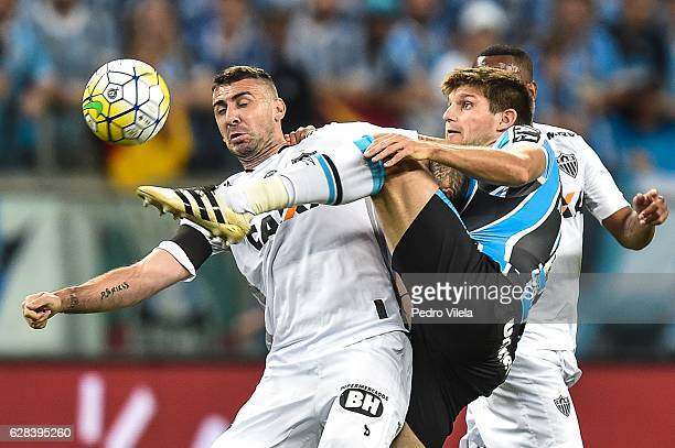 Kannemann of Gremio and Lucas Pratto of Atletico MG battle for the ball during a match between Gremio and Atletico MG as part of Copa do Brasil Final...