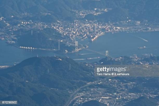 Kannon Straits between Shimonoseki city in Yamaguchi prefecture and Kitakyushu city in Fukuoka prefecture in Japan sunset time aerial view from airplane