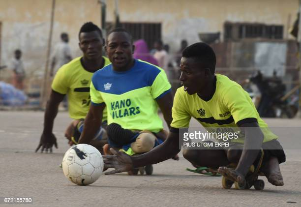 Kano Pillars parasoccer player advances with the ball during a training session in Kano northwestern Nigeria on April 22 2017 The World Health...