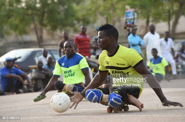 Kano Pillars parasoccer team player advances with the ball during a training session in Kano northwestern Nigeria on April 22 2017 The World Health...