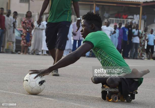 A Kano Pillars parasoccer team player advances with the ball during a training session in Kano northwestern Nigeria on April 22 2017 The World Health...
