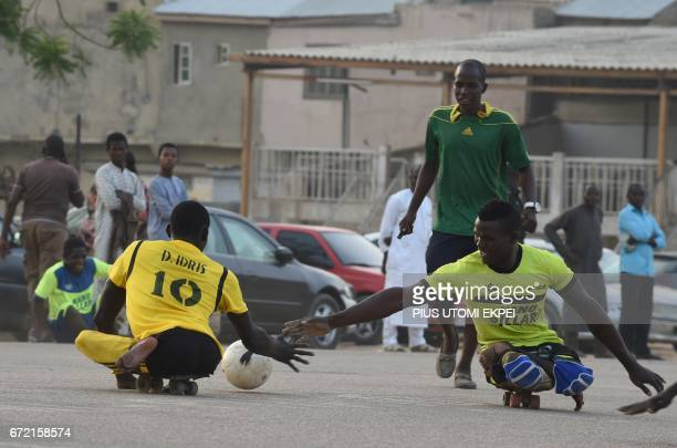 Kano Pillars parasoccer team players vie for the ball during a training session in Kano northwestern Nigeria on April 22 2017 The World Health...