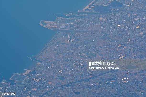 Kanonji city and Seto Inland Sea, daytime aerial view from airplane