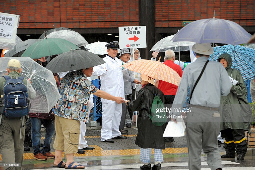 Kansai Electoric Powe Co shareholders walk to the annual shareholders meeting site on June 26, 2013 in Kobe, Hyogo, Japan. Japan's all nine electric power companies hold shareholders meeting, denied 72 shareholders proposals of nuclear-free power generation, took clear stance of restarts of nuclear power plants in Japan.