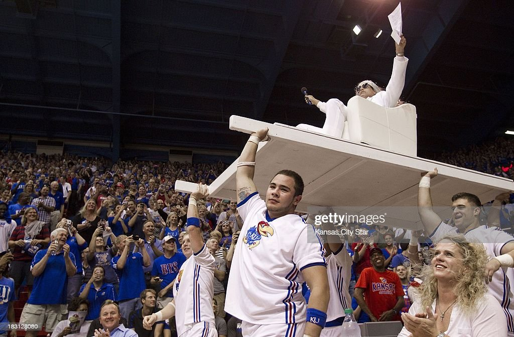 Kansas alum and movie star Rob Riggle is carried in by cheerleaders as he emcee'd for the men's basketball team skits during the University of Kansas Late Night at Phog Allen Fieldhouse in Lawrence, Kansas, Friday, October 4, 2013.