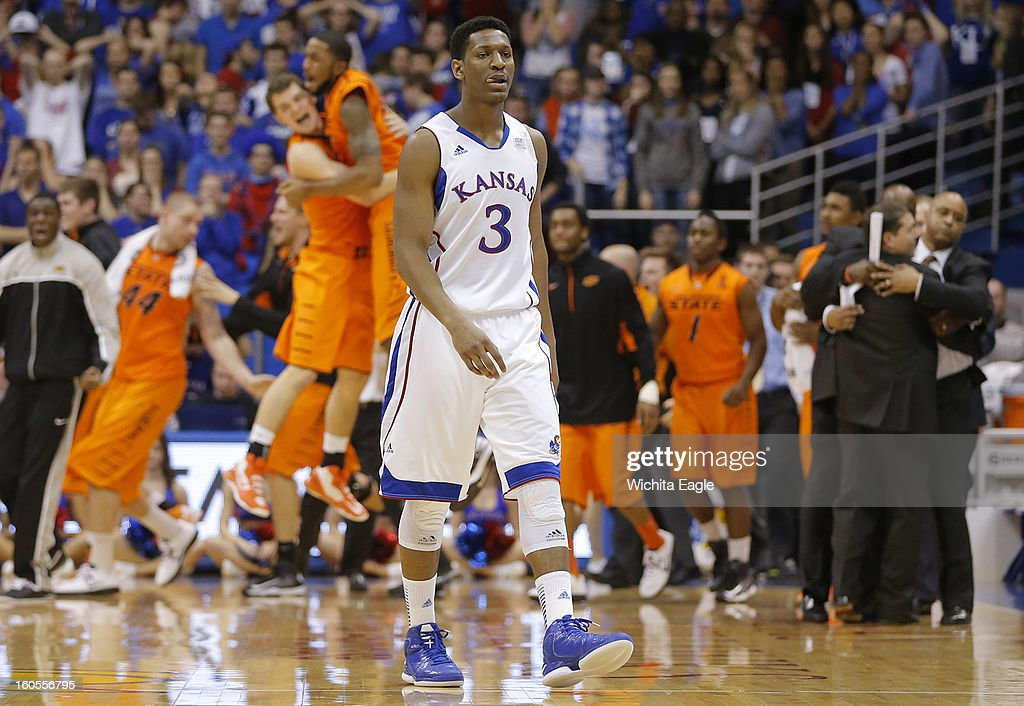 Kansas' Andrew White III walks off the court after an 85-80 upset by Oklahoma State at Allen Fieldhouse in Lawrence, Kansas, on Saturday, February 2, 2013.