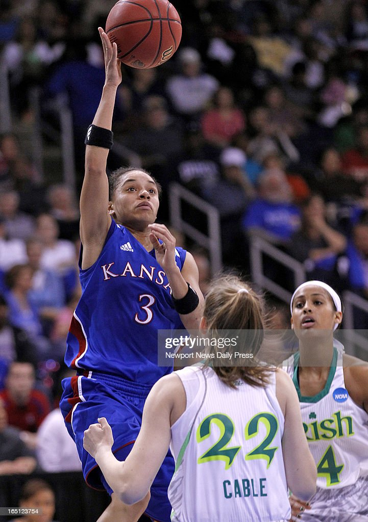 Kansas' Angel Goodrich, left, shoots the ball over Notre Dame's Madison Cable, center, and Skylar Diggins, right, during Sunday's NCAA women's basketball regional semifinal on March 31, 2013, at the Ted Constant Center in Norfolk, Virginia.