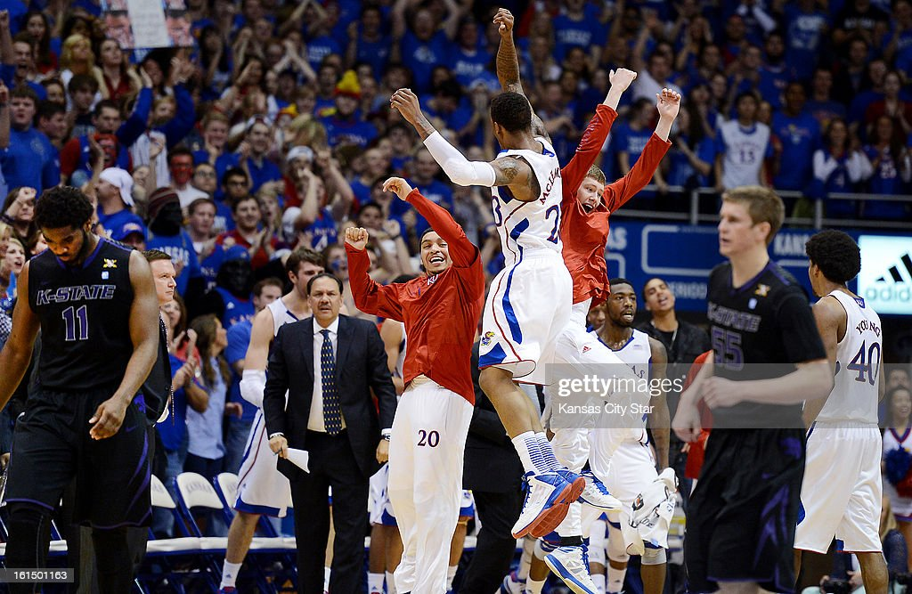 Kansas' Ben McLemore celebrates with Tyler Self, right, son of head coach Bill Self, after McLemore converted a fast break for another Jayhawks bucket against Kansas State at Allen Fieldhouse in Lawrence, Monday, February 11, 2013.