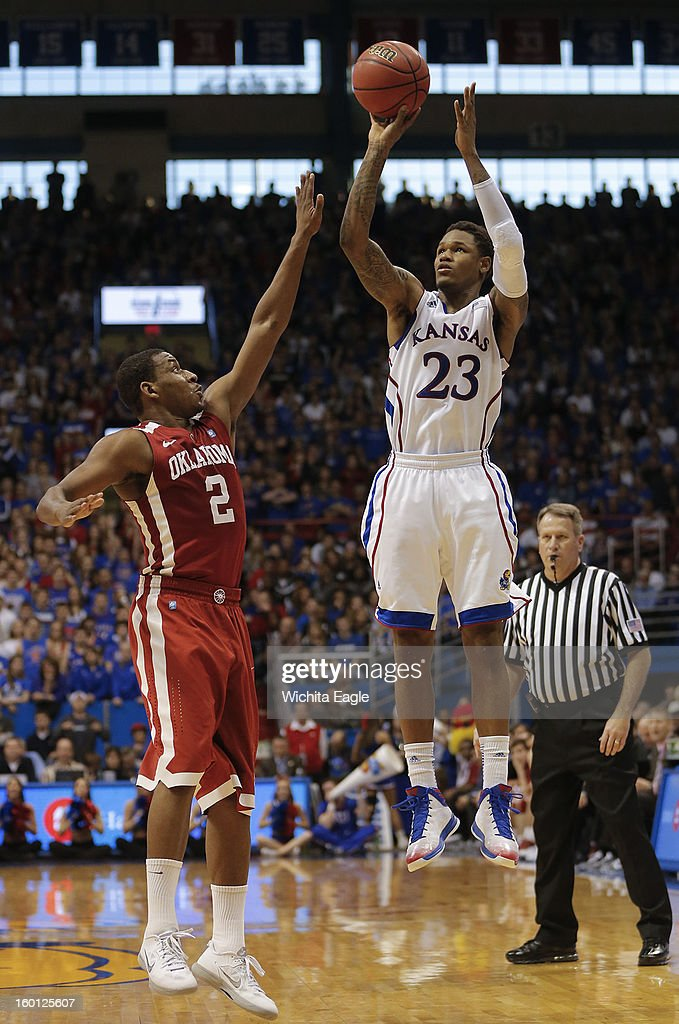 Kansas' Ben McLemore takes a 3-point shot against Oklahoma's Steven Pledger during the second half at Allen Fieldhouse in Lawrence, Kansas, on Saturday, January 26, 2013. Kansas won, 67-54.