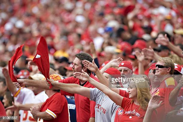 Kansas City Chief fans do the tomahawk chop during a game against the Oakland Raiders at Arrowhead Stadium on September 20 2009 in Kansas City...