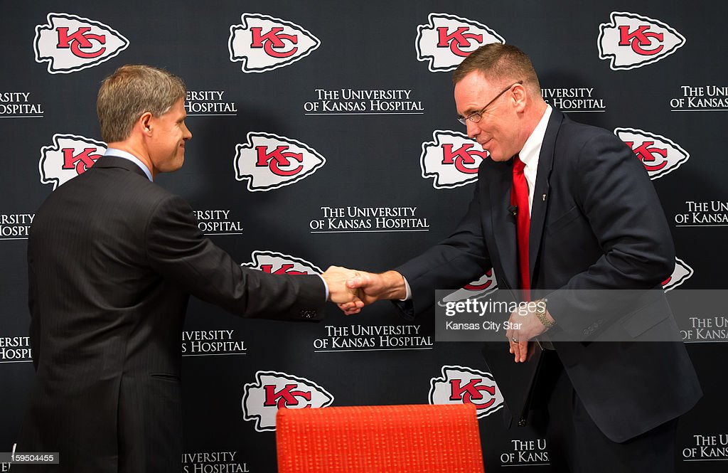 Kansas City Chiefs chairman and CEO Clark Hunt, left, shook hands with his new general manager, John Dorsey, right, during Dorsey's introductory press conference on Monday, January 14, 2013, at the team's practice facility in Kansas City, Missouri. Dorsey moves from the Green Bay packers organization where we was the team's director of football operations.