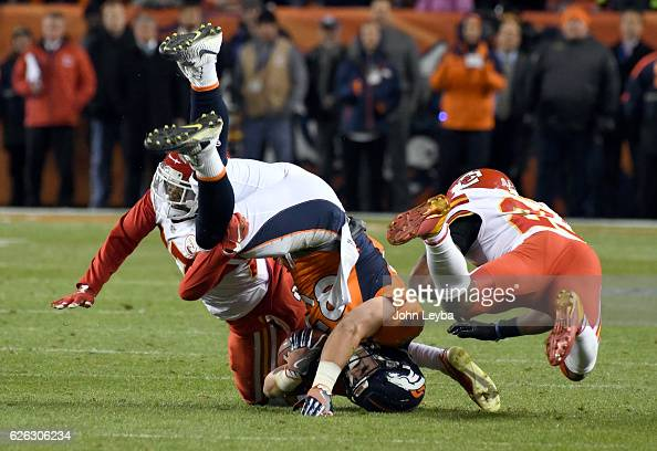 Kansas City Chiefs cornerback Kenneth Acker and Kansas City Chiefs strong safety Eric Berry put a hit on Denver Broncos tight end AJ Derby after a...