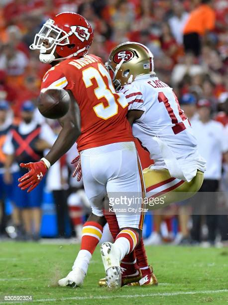 Kansas City Chiefs defensive back De'Vante Bausby left breaks up a pass intended for San Francisco 49ers wide receiver DeAndre Carter in the third...