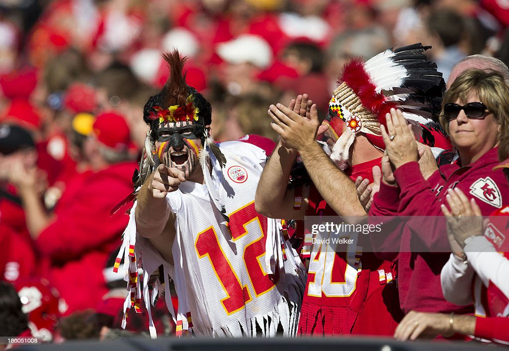 A Kansas City Chiefs fan celebrates the Kansas City Chiefs scoring during the game against the Cleveland Browns at Arrowhead Stadium on October 27, 2013 in Kansas City, Missouri.