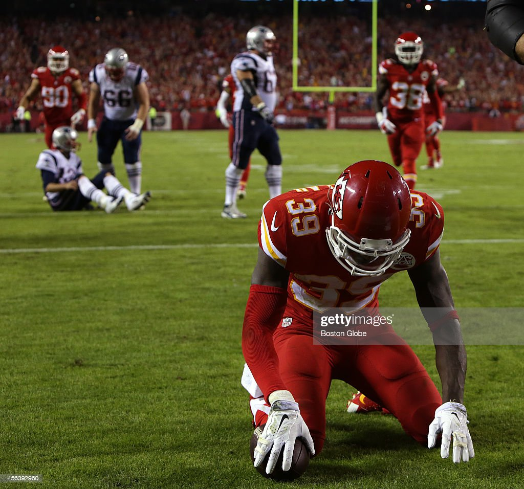 Kansas City Chiefs free safety <a gi-track='captionPersonalityLinkClicked' href=/galleries/search?phrase=Husain+Abdullah&family=editorial&specificpeople=2190074 ng-click='$event.stopPropagation()'>Husain Abdullah</a> bows his head in prayer after picking off a pass from New England Patriots quarterback <a gi-track='captionPersonalityLinkClicked' href=/galleries/search?phrase=Tom+Brady+-+American+Football+Quarterback&family=editorial&specificpeople=201737 ng-click='$event.stopPropagation()'>Tom Brady</a>, seated in the back left, and returning it for a pick six touchdown in the fourth quarter. Abdullah was penalized for excessive celebration, which drew criticism and and acknowledgement from NFL officials that he should not have been penalized.