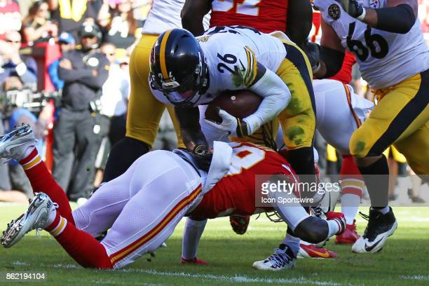 Kansas City Chiefs free safety Ron Parker goes low to tackle Pittsburgh Steelers running back Le'Veon Bell in the second quarter of a week 6 NFL game...