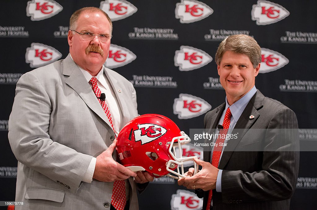 Kansas City Chiefs head coach Andy Reid, left, and Chiefs CEO Clark Hunt, pose for a photo following Reid's first news conference Monday, January 7, 2013, at Arrowhead Stadium in Kansas City, Missouri, as head coach of the AFC West team, hired to replace former head coach Romeo Crennel.