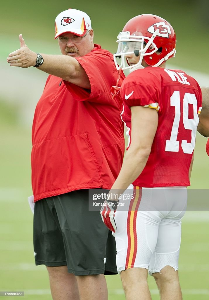 Kansas City Chiefs head coach Andy Reid speaks to Chiefs wide receiver Devon Wylie (19) during position drills at Chiefs training camp at Missouri Western State University in St. Joseph, Missouri, Sunday, August 4, 2013.