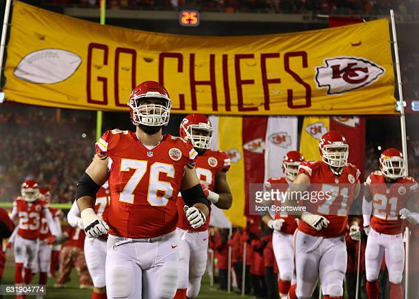 Kansas City Chiefs offensive guard Laurent DuvernayTardif and teammates run onto the field before the AFC Divisional playoff game between the...