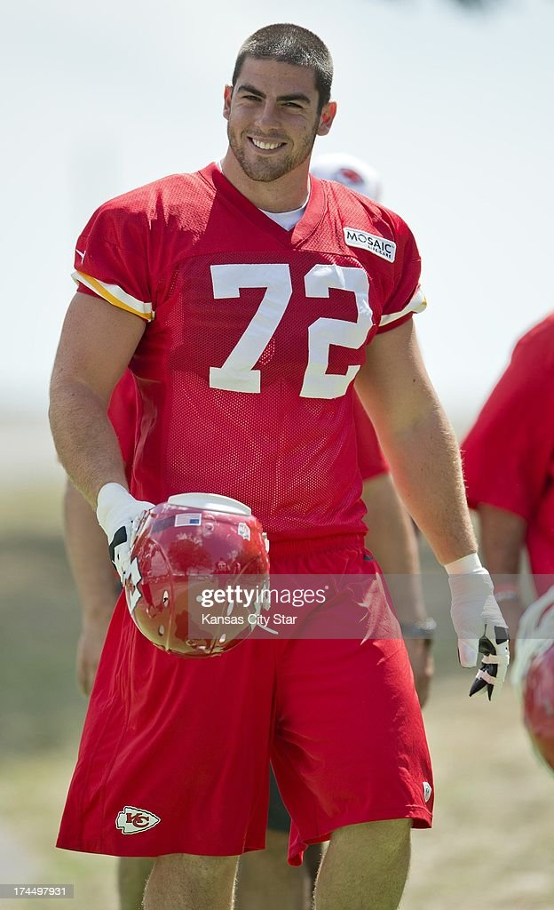 Kansas City Chiefs offensive tackle Eric Fisher (72), the No. 1 overall pick in the 2013 NFL Draft, walks to the practice field after signing his contract earlier in the day at Chiefs training camp at Missouri Western State University in St. Joseph, Missouri, Friday, July 26, 2013.