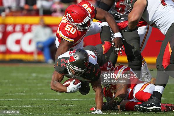 Kansas City Chiefs outside linebacker Justin Houston makes the tackle on Tampa Bay Buccaneers running back Doug Martin during a week 11 NFL game...