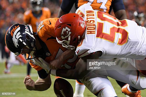 Kansas City Chiefs outside linebacker Justin Houston sacks and forces a fumble that would lead to a safety on Denver Broncos quarterback Trevor...