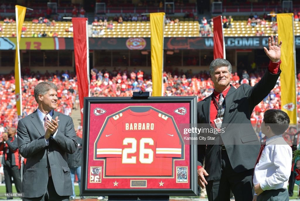 Kansas City Chiefs owner Clark Hunt applauds as Gary Barbaro is introduced as the newest member of the Chiefs Hall of Fame during halftime of Sunday's football game against the New York Giants at Arrowhead Stadium in Kansas City, Missouri, on September 29, 2013. The Chiefs won, 31-7.