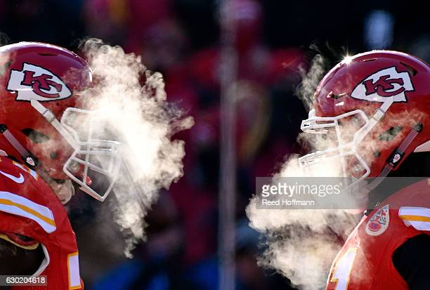 Kansas City Chiefs players' breath masks their faces during the game against the Tennessee Titans at Arrowhead Stadium on December 18 2016 in Kansas...