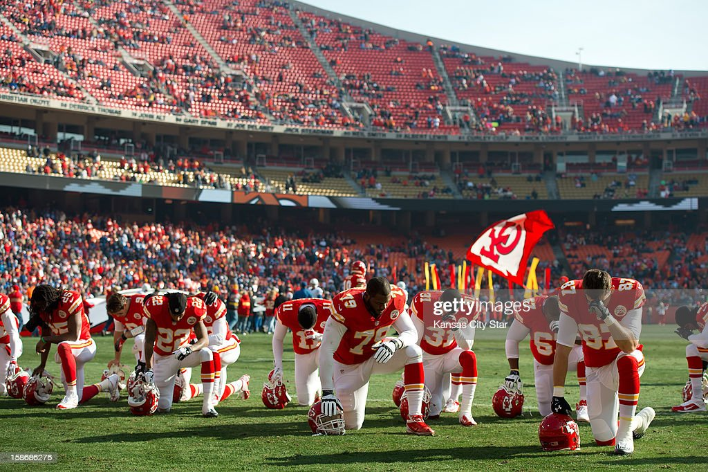 Kansas City Chiefs players pause for a pregame prayer prior to NFL action against the Indianapolis Colts at Arrowhead Stadium on Sunday, December 23, 2012, in Kansas City, Missouri. The Indianapolis Colts defeated the Kansas City Chiefs, 20-13.