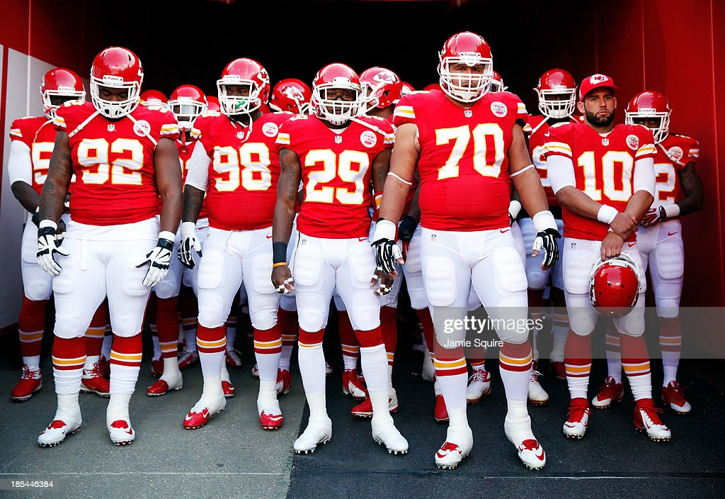 Kansas City Chiefs players wait to take the field during player introductions ahead of the game against the Houston Texans at Arrowhead Stadium on October 20, 2013 in Kansas City, Missouri.