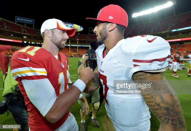 Kansas City Chiefs quarterback Alex Smith and San Francisco 49ers quarterback Colin Kaepernick meet after a 1513 49ers win during preseason action on...