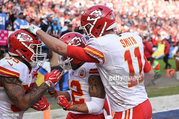 Kansas City Chiefs Quarterback Alex Smith celebrates with Kansas City Chiefs Running Back Charcandrick West after his touchdown during an NFL regular...