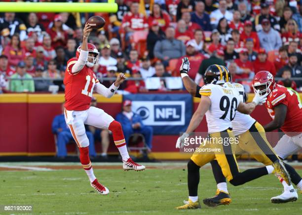 Kansas City Chiefs quarterback Alex Smith jumps to complete a pass in the second quarter of a week 6 NFL game between the Pittsburgh Steelers and...