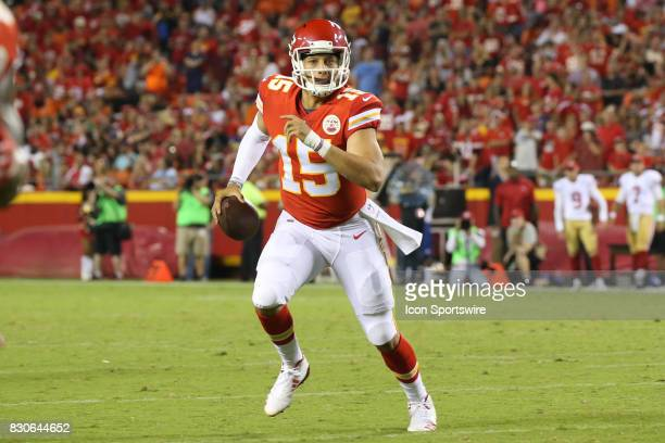 Kansas City Chiefs quarterback Patrick Mahomes rolls out before throwing a 1yard touchdown pass in the third quarter of an NFL week 1 preseason game...