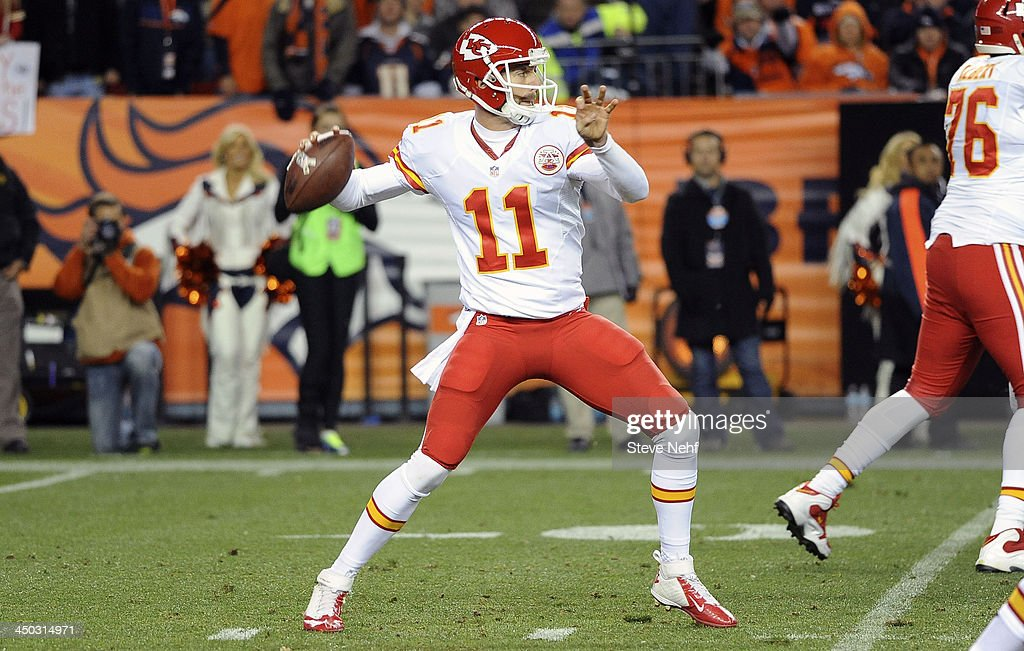 Kansas City Chiefs quarterback Peyton Manning sets up to throw in the second quarter against the Denver Broncos at Sports Authority Field at Mile High in Denver on November 17, 2013.
