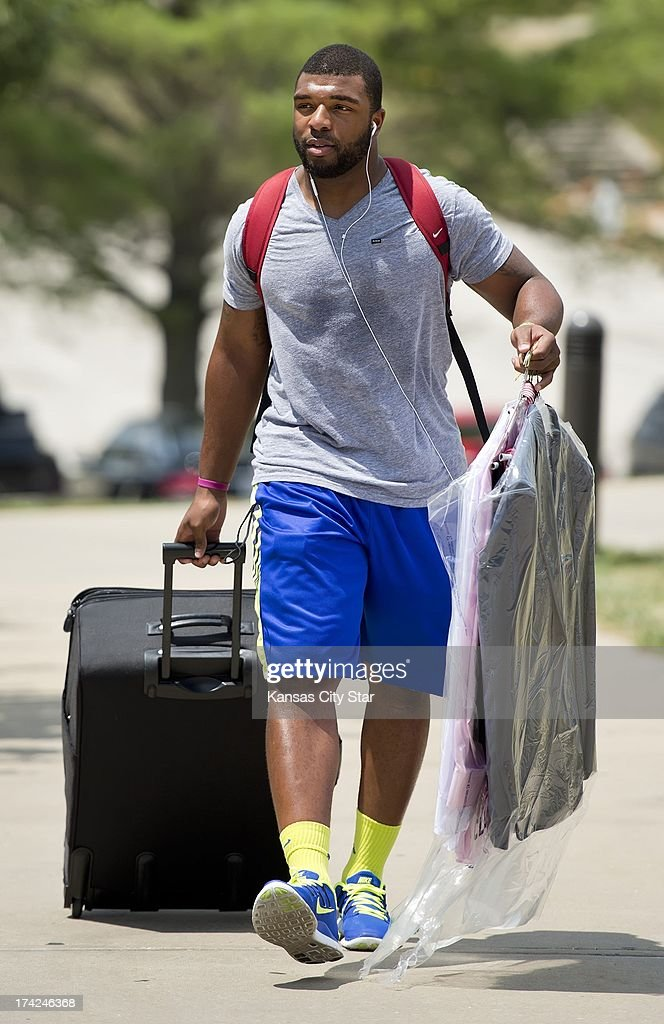 Kansas City Chiefs rookie linebacker Nico Johnson, the team's fourth-round draft pick from Alabama, arrives at Scanlon Hall dormitory for Chiefs training camp at Missouri Western State University in St. Joseph, Missouri, Monday, July 22, 2013.