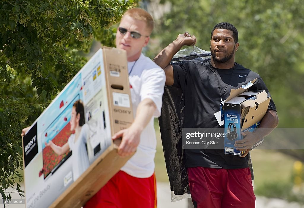 Kansas City Chiefs rookie running back Knile Davis, the team's third-round draft pick, carries a refrigerator box into the Scanlon Hall dormitory at Chiefs summer training camp at Missouri Western State University in St. Joseph, Missouri, Monday, July 22, 2013.
